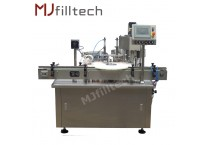 Automatic eye drop filling and capping machine
