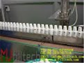 MJ GFT Filling and plugging and capping machine