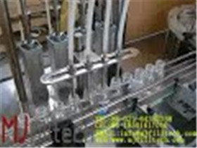 MJ GFT Liquid filling and capping machine